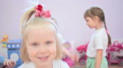Girl dancing in kindergarten, smiling and surprised Stock Footage