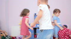 Children running around in kindergarten and laughing - stock footage