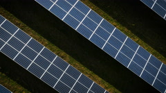 Aerial drone footage spinning over UK solar panels Stock Footage