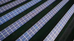 Aerial drone footage drifting over UK solar panels Stock Footage