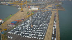 Cars ready for export at Southampton Port, UK filmed by drone Stock Footage