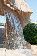 Artificial Waterfall in the Gardens of a Luxury Resort Hotel Stock Photos