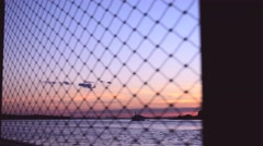 Dolly in on fence with statue of liberty behind - stock footage
