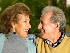 Senior couple smiling at each other Stock Photos