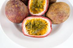 Sliced Passion Fruit on a Plate Stock Photos
