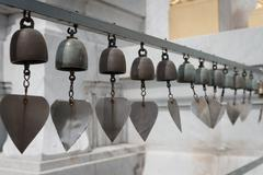 Tiny Metal Bells as Wind Chimes Stock Photos