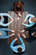 Top view of business people at wooden table Stock Photos