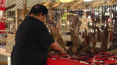 Tongan woman with crafts and jewelery in market stall, people or person in shot, Stock Footage