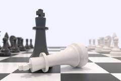 Two chess pieces on a chessboard - stock photo