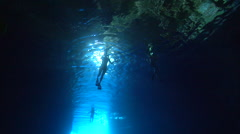Ocean scenery snorkellers in swallows cave, people or person in shot, in cavern, Stock Footage