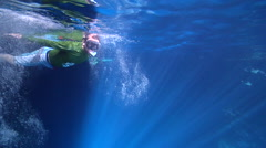 Freediver swimming in cavern in Kingdom of Tonga, HD, UP15470 Stock Footage