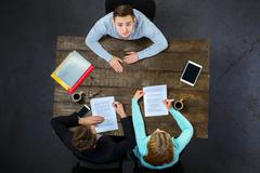 Top view of employee and employers at table - stock photo