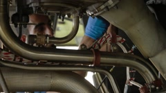 Engineers Servicing Large Jet Engine - stock footage