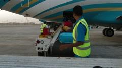 Unload Baggage On Conveyor - stock footage