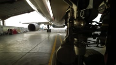 Airplane Parked At The Airport Hangar Stock Footage