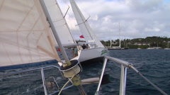 View from pulpit, another yacht on front, close sailing, people or person in - stock footage