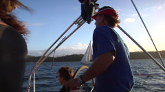 Captain turns boat toward setting sun, sailing, people or person in shot, HD, Stock Footage