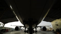 Undercarriage Of The Airplane In Hangar Stock Footage