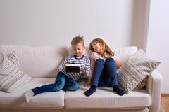 Girl and boy wearing virtual reality goggles. Studio shot Kuvituskuvat
