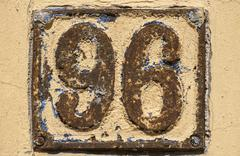 Old retro cast iron plate number 96 - stock photo