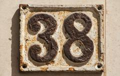Old retro cast iron plate number 38 - stock photo