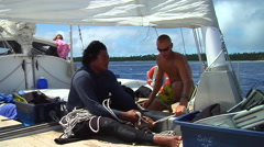 Crew heaving on lines to hoist sail, people or person in shot, HD, UP15818 Stock Footage