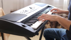 closeup of male hands playing piano. Man Playing the synthesizer keyboard. - stock footage
