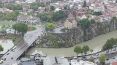 Aerial view of old Tbilisi capital of Georgia. Kura river and Metehi monastery Stock Footage