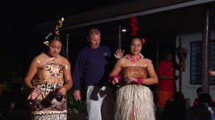 Tongan women dancing, tourists sticking money on them, people or person in shot, Stock Footage