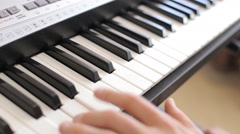 Closeup of male hands playing piano. Man Playing the synthesizer keyboard. Stock Footage
