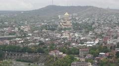 Aerial view of Tbilisi, Georgia. Tsminda Sameba (Holy Trinity) monastery Stock Footage