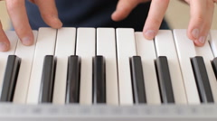 Stock Video Footage of closeup of male hands playing piano. Man Playing the synthesizer keyboard.