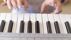 Woman playing a synthesizer - close-up video of a woman hands Stock Footage