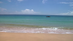 Perfect beach with small boat and small waves breaking, HD, UP15877 Stock Footage
