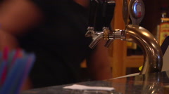 Tongan barmaid pouring draft beer, people or person in shot, HD, UP15974 Stock Footage