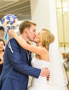 Stylish gorgeous happy bride and groom kissing at wedding reception, emotional Stock Photos
