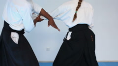 Two persons in black hakama practice Aikido on martial arts training - stock footage