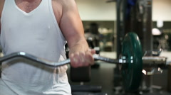Strong man, bodybuilder exercising in a gym Stock Footage