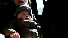 Mother Holding Her Baby Boy in Car Stock Footage