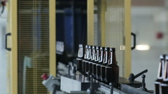 Bottle manufacturing technology in industrial factory. Glass recycling. Movement Stock Footage
