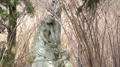 Stone Maiden sculpture on graveyard in a very old cemetery - stock footage