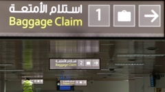 Baggage Claim Sign Hanging From Ceiling Stock Footage