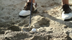 Golf Ball in Sand Trap - stock footage