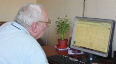 old man watching the computer map - stock footage