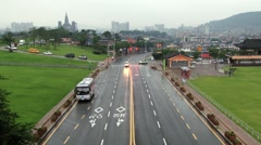 Cars pass by the road in rainy weather in Suwon, Korea. Stock Footage