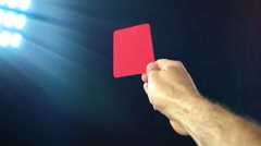 Soccer penalty red card on black background, slow motion Stock Footage