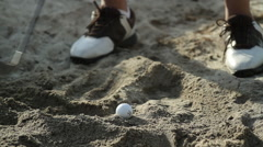 Golfball in Sand - stock footage