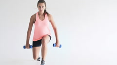 Young fit woman doing lunge exercises Stock Footage