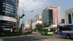 Cars and buses pass by the street of the city in Daejeon, Korea. Stock Footage