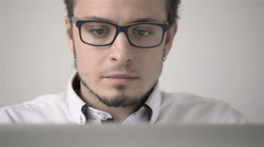 Handsome Young Man In Shirt Working On Laptop While Sitting At His Working Place Stock Footage